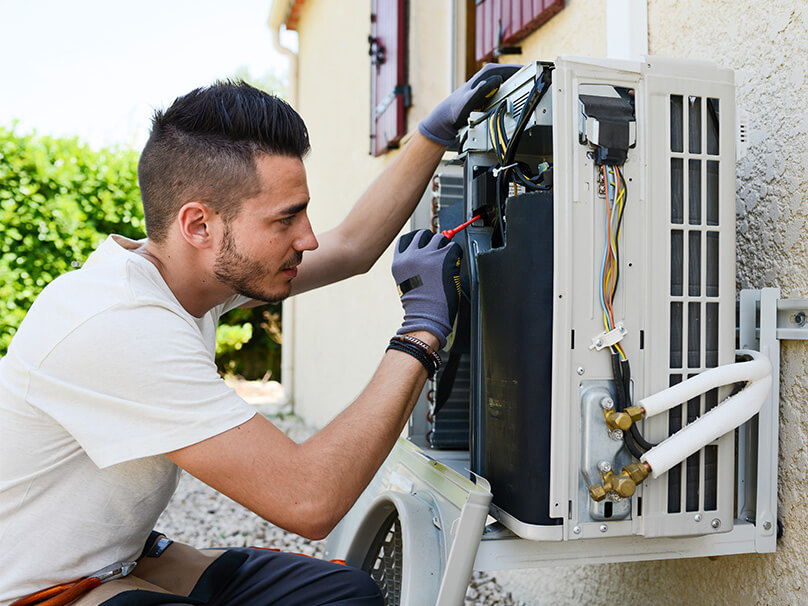Man working on an air conditioner
